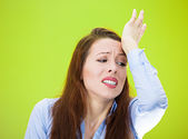 Woman with hand on forehead very upset — Stock Photo