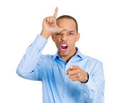 Man showing loser sign on forehead — Stock Photo