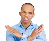 Young man with hands in X sign telling someone to stop talking — Stock Photo