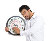 Worker holding clock — Stockfoto