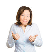 Woman giving thumbs up sign — Stock Photo