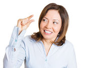 Young woman showing small amount gesture — Stockfoto