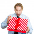 Young man about to open unwrap red gift box — Stock Photo #43714677