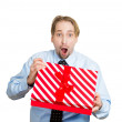 Young man about to open unwrap red gift box — Stock Photo #43714683