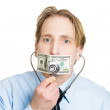 Professional placing stethoscope to hundred dollar bill taped to mouth — Stock Photo #43714697
