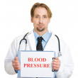 Cardiologist with stethoscope holding sign blood pressure — Stock Photo #43714811