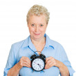 Woman holding alarm clock — Stock Photo #43715051
