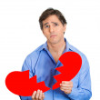 Guy holding broken heart — Stock Photo #43715613