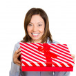 Woman offering you a red gift box — Stock Photo #43715769