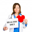 Cardiologist with stethoscope holding sign healthy diet — Stock Photo