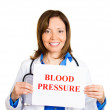 Cardiologist with stethoscope holding sign blood pressure — Stock Photo #43716179