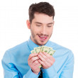 Man holding money dollar bills — Stock Photo