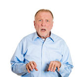 Mature man looking shocked — Stock Photo