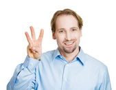 Man giving a three times fingers sign — Stock Photo