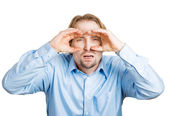 Man trying to see something with imaginary binoculars — Stock Photo