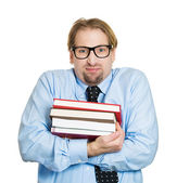 Nerdy guy holding books — Foto Stock