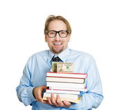 Man holding books in arms with money on top — Stock Photo