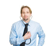 Man listening to his heart with stethoscope — Stock Photo