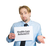 Man holding a sign health care reform — Stock Photo
