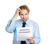 Man unhappy with monthly statement — Stock Photo