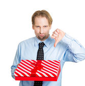Upset man holding gift box — Stock Photo