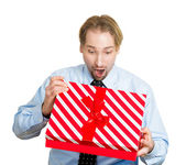 Young man about to open unwrap red gift box — Stock Photo