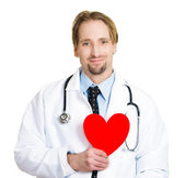 Doctor holding a heart — Stock Photo