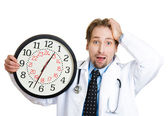 Doctor holding big clock — Stock Photo