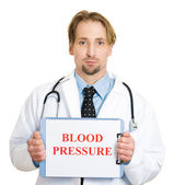 Cardiologist with stethoscope holding sign blood pressure — Stock Photo