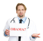 Doctor holding up a sign Obama? — Stock Photo