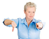 Woman with bad attitude showing thumbs down sign hand — Stock Photo