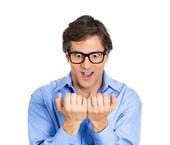 Man anxiously staring at fingernails — Stock Photo