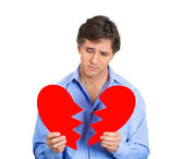 Guy holding broken heart — Stock Photo