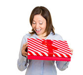 Woman about to open unwrap red gift box — Stock Photo