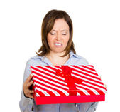 Woman holding red gift box displeased — Stock Photo