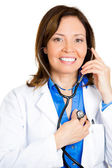 Doctor listening to her heart with stethoscope — Stock Photo