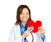 Doctor listening to heart — Foto Stock