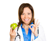 Health care professional holding an apple — Stock Photo
