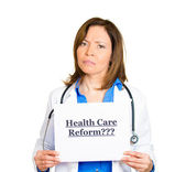 Doctor with stethoscope holding up sign health care reform? — Foto de Stock