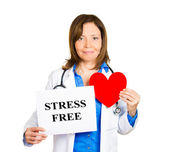 Cardiologist with stethoscope holding sign stress free — Stock Photo
