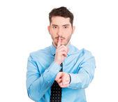 Man placing finger on lips to say shh — Stock Photo