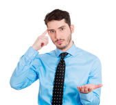 Man gesturing with finger against his temple — Stock Photo
