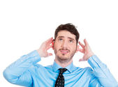 Stressed  man covering ears — Stock Photo