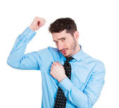 Young man sniffing his wet armpit — Stock Photo