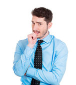 Thinking man with finger in mouth — Stockfoto