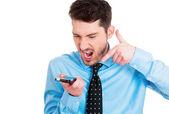 Man angry on cellphone — Stok fotoğraf