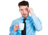 Tired man with cup of coffee — Stockfoto