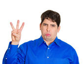 Sad man looking at you, holding number three gesture by hand — Stockfoto