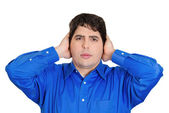 Man covering his ears — Stock Photo