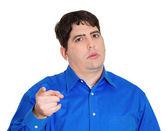 Serious man pointing at someone — Stockfoto